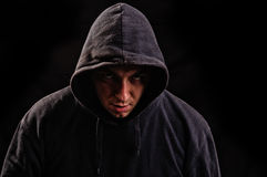 Man with hoodie or hooligan over dark background Stock Image
