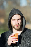 Man in hoodie with paper coffee, tea cup Royalty Free Stock Photography