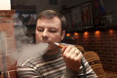 Man at hookah house Stock Photography