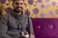 Man With Hookah Shisha And Glowing Acharcoal Stock Images