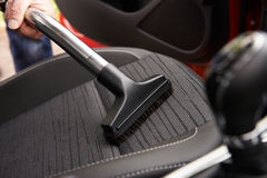 Man Hoovering Seat Of Car During Car Cleaning Royalty Free Stock Photo