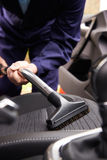 Man Hoovering Seat Of Car During Car Cleaning Stock Photography