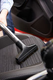 Man Hoovering Seat Of Car During Car Cleaning Royalty Free Stock Photos