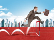 Man Hopping Over Treadmill Barrier With City Stock Photo