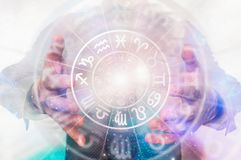 Man with horoscope circle in his hands - predictions of the futu. Man with horoscope circle in his magic hands - concept of predictions of the future stock images