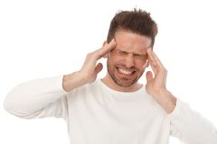 Man with horrible headache Royalty Free Stock Photography