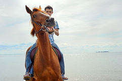 Man on horse. Man riding on a brown horse Royalty Free Stock Photo
