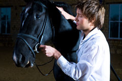 Man with the horse Stock Photography