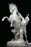 Man with horse - Beautiful sculpture on black background Royalty Free Stock Photo