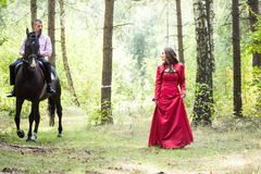 Man on horse and girl Royalty Free Stock Photo