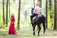 Man on horse and girl Royalty Free Stock Images