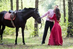 Man on horse and girl Stock Photos