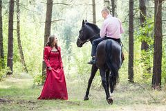 Man on horse and girl Stock Photo