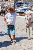Man with horse - Greece islands Royalty Free Stock Image