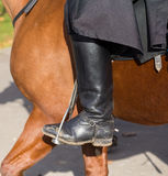 Man on a horse. Mud boot. Stock Photo