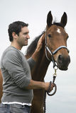 Man With Horse Outdoors Stock Photography