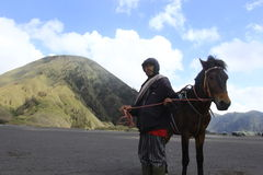 Man and Horse. A man rentaling a hores at Bromo's Mountain Area Royalty Free Stock Image