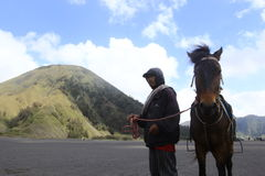 Man and Horse. A man rentaling a hores at Bromo's Mountain Area Royalty Free Stock Photography