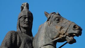 A man and a horse statue. A close up shot of a statue. A man and a horse stock footage