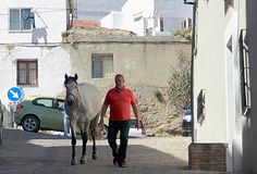Man and horse on the street of Ronda stock image