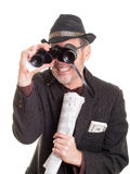 Man at the horse track with binoculars Stock Photo