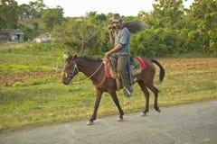 A man on a horse in the Valle de Vi�ales, in central Cuba Stock Photos