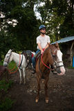 Man on horseback in Costa Rica Royalty Free Stock Photo