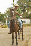 Man on horseback in rural Cuba in small village Stock Photos