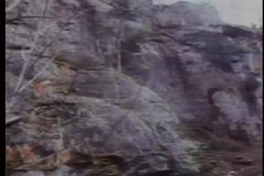 Man and horses falling from a cliff stock video footage
