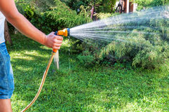 Man with hose Royalty Free Stock Image