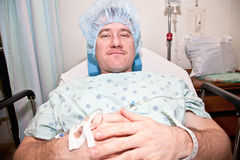 Man in Hospital. Man in a hospital bed resting Royalty Free Stock Images