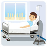 Man at Hospital Bed Royalty Free Stock Photos