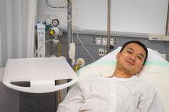 Man in hospital bed. Man asia in hospital bed . He is a patient in the emergency room Royalty Free Stock Photos