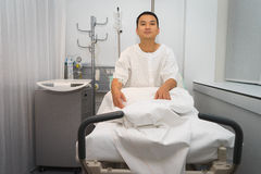 Man in hospital bed Stock Photo
