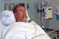 Man in hospital bed asleep