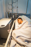 Man in hospital bed asleep Royalty Free Stock Photography