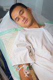 Man in hospital bed asleep Royalty Free Stock Image