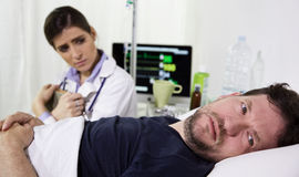 Man in hospital bed, scared after receiving the diagnostic test results. He is seriously ill Royalty Free Stock Photos