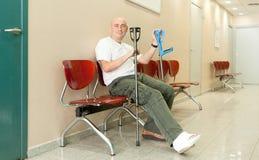 Man   in  hospital corridor Stock Image