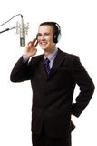 Man host at radio station speak to microphone. Wearing suit,isolated on white stock photo
