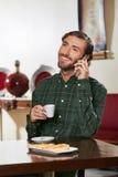 Man in hotel drinking espresso Stock Photo