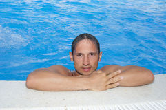 Man at hotel indoor water pool Royalty Free Stock Photo