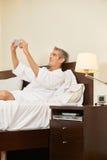 Man in hotel room taking selfie Stock Photos