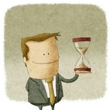Man with hourglass in hand Stock Photography