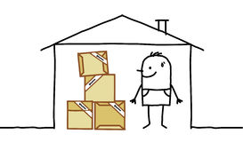 Man in house & cardboard packing Royalty Free Stock Photos