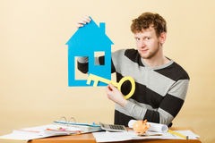 Man with house and key. Stock Photo