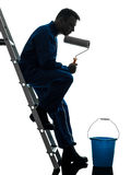 Man house painter worker silhouette. One caucasian man house painter worker silhouette in studio on white background Stock Image