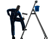 Man house painter worker silhouette. One caucasian man house painter worker silhouette in studio on white background Stock Photo