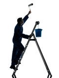 Man house painter worker silhouette. One  man house painter worker silhouette in studio on white background Stock Photos