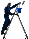 Man house painter worker silhouette. One  man house painter worker silhouette in studio on white background Stock Image